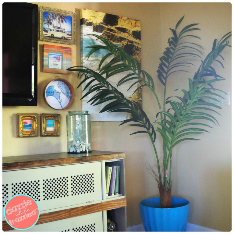 Complete a gallery feature wall with artificial plant from Commercial Silk.
