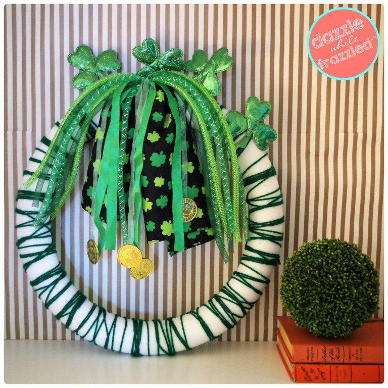 Easy and fast St. Patrick's Day decor using foam wreath, green yarn and dollar store shamrock ribbon headbands