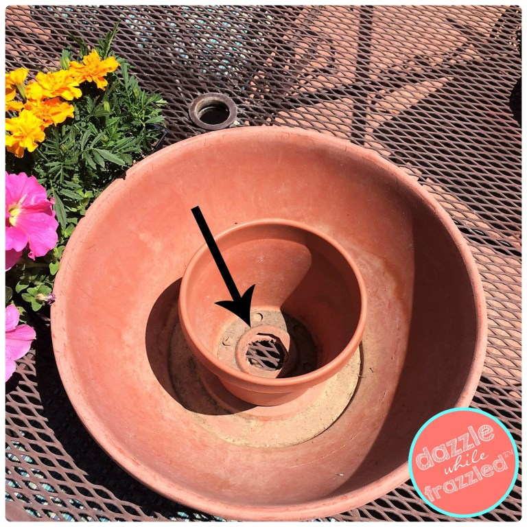 Place two plastic flower pots together to plant around a patio table umbrella.