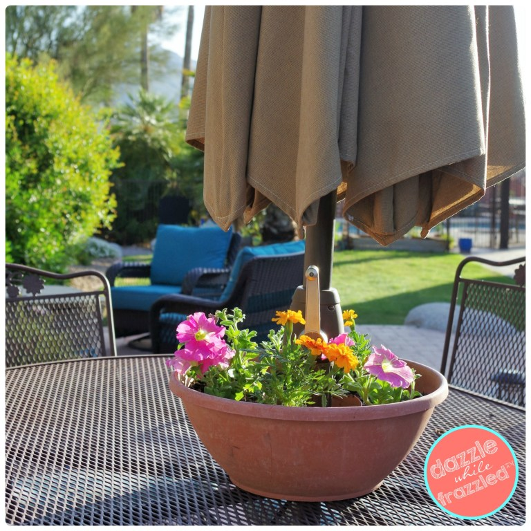Put two plastic flower pots together to make an easy patio umbrella table pretty springtime summertime planter.