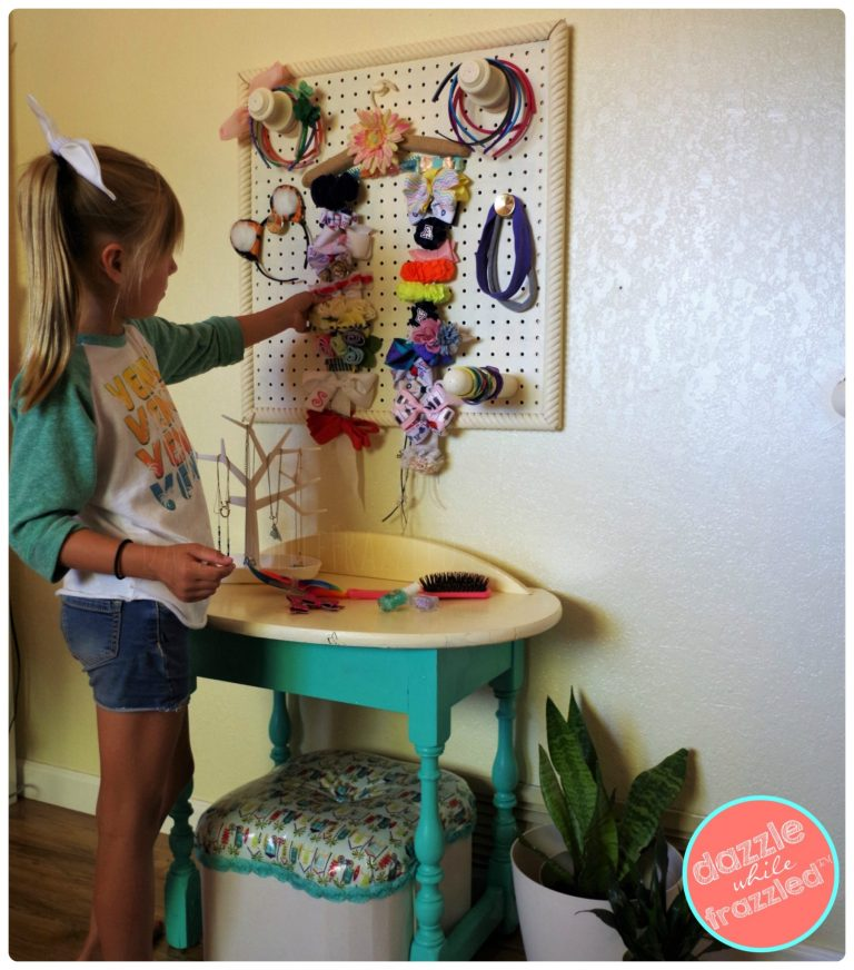 Make a girls beauty station in her bedroom with hair organizer.