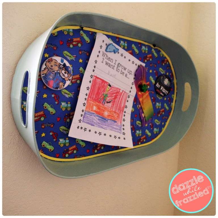 Display kids artwork and keepsakes with DIY fabric-covered magnet board made from metal serving tray.