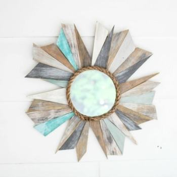 How to make a driftwood inspired sunburst mirror with scrap wood and rope.