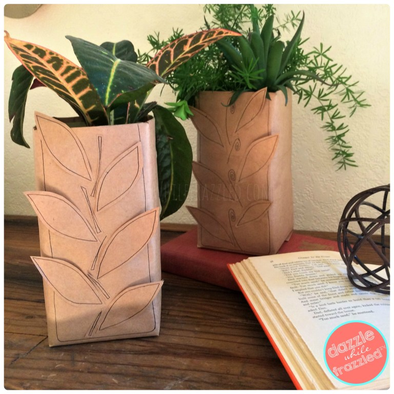 Thrifty DIY autumn home decor with brown paper bag and fall leaves vase.