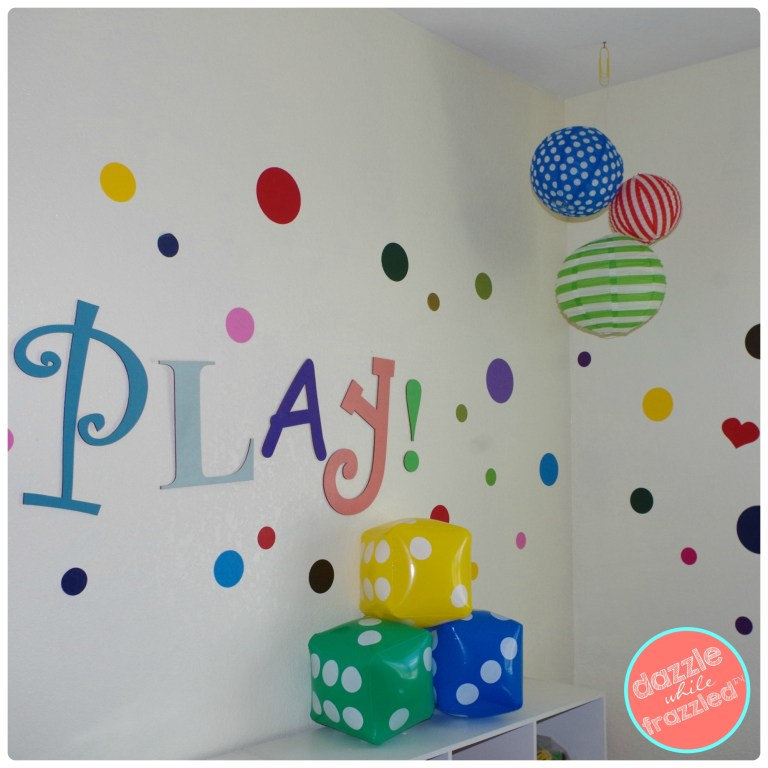 Hang paper lanterns, a large kite or an unusual mobile from the ceiling to make a DIY super fun kids toy room.