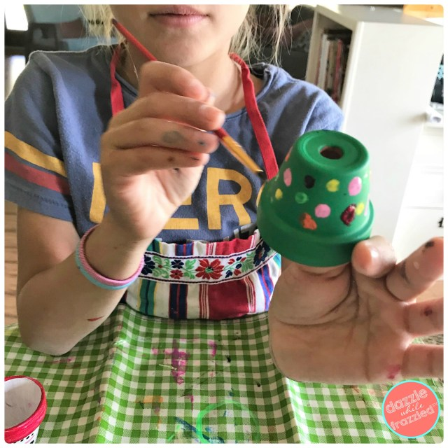 Turn mini clay flower pot into Christmas tree, Santa Claus belt or snowman face for DIY Christmas tree ornaments or Christmas present decorations.