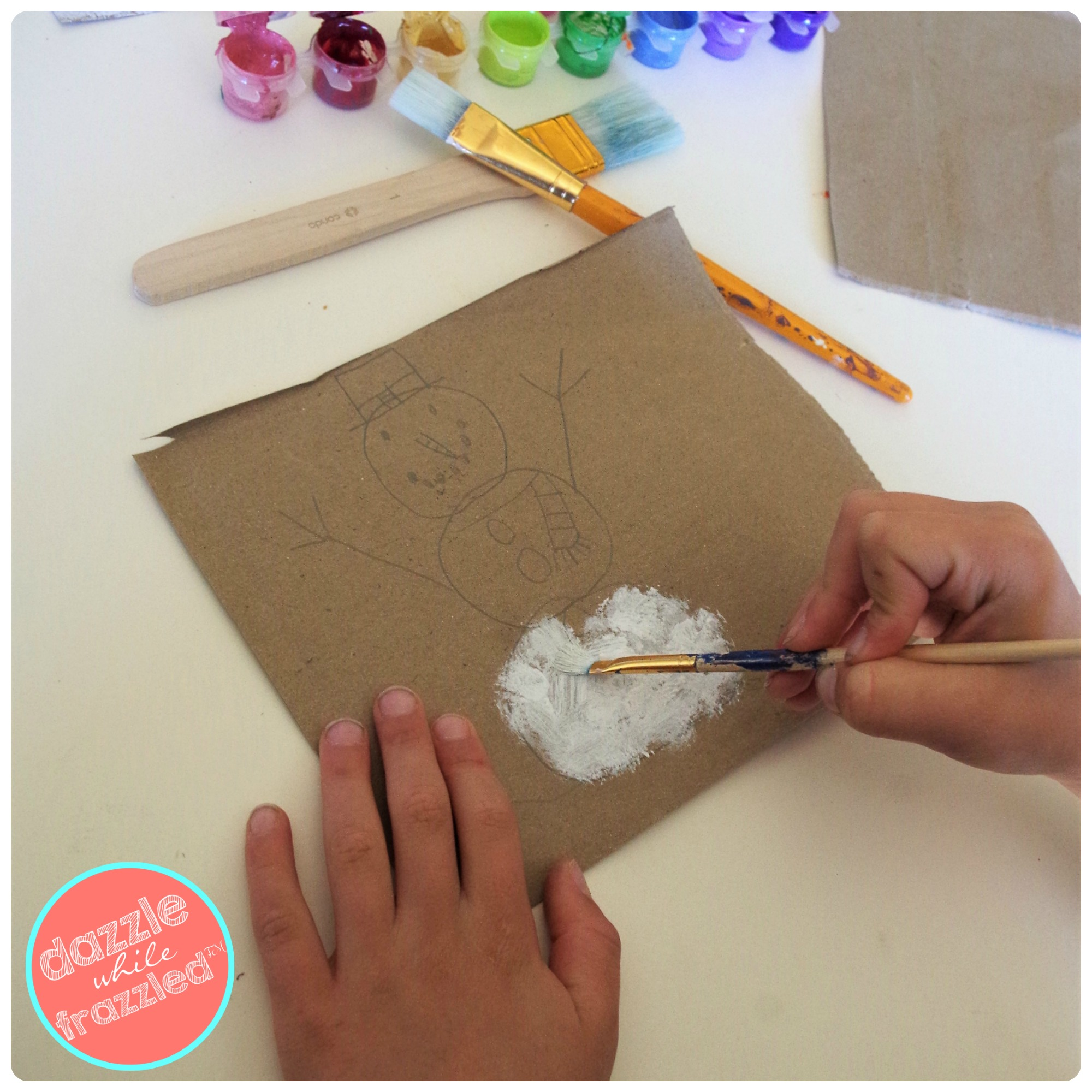 How to make quick and easy winter snowman painting craft with kids using brown paper grocery bag canvases.