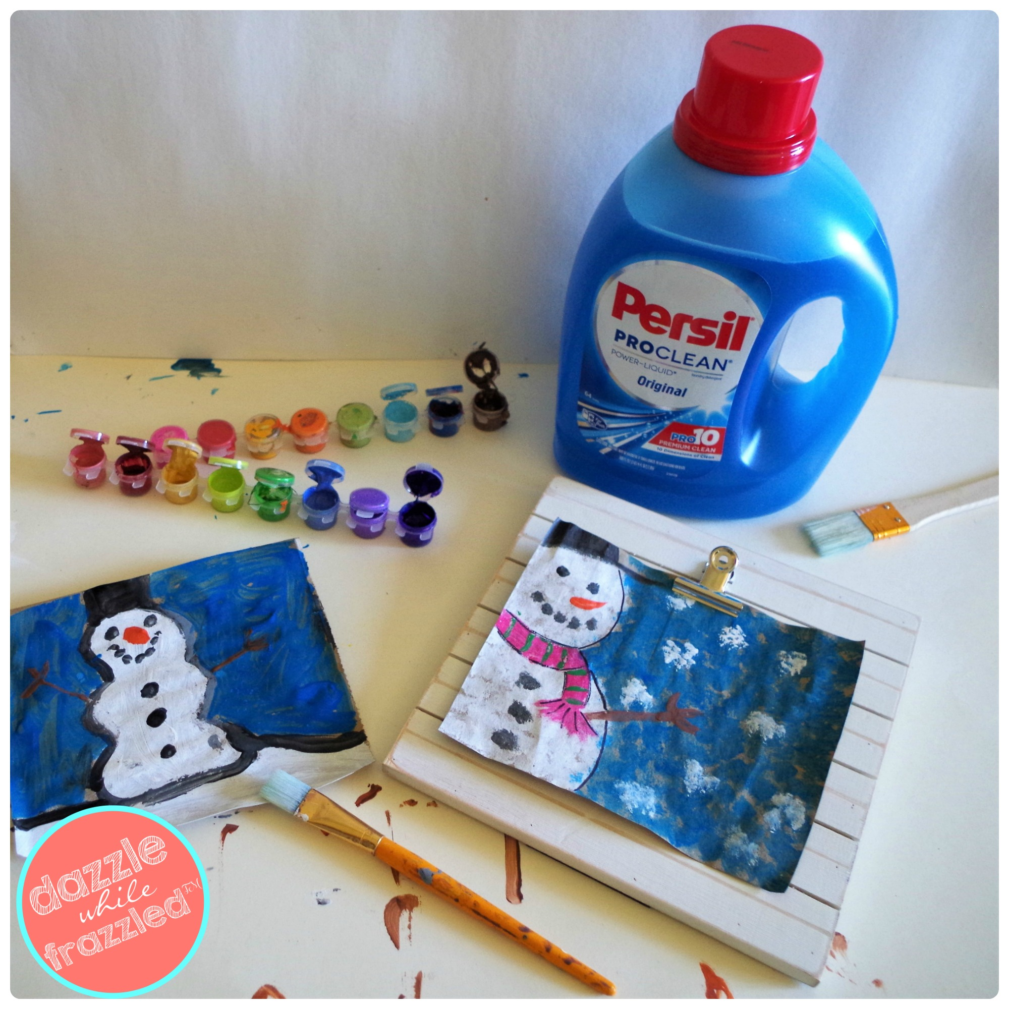 DIY easy snowmen winter Christmas art. Easy arts-n-crafts project clean up with Persil laundry detergent to remove paint from kids clothing.