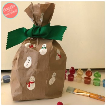 Make affordable DIY gift wrapping with hand painted snowmen on brown paper gift wrapping. Great Christmas winter craft for kids.