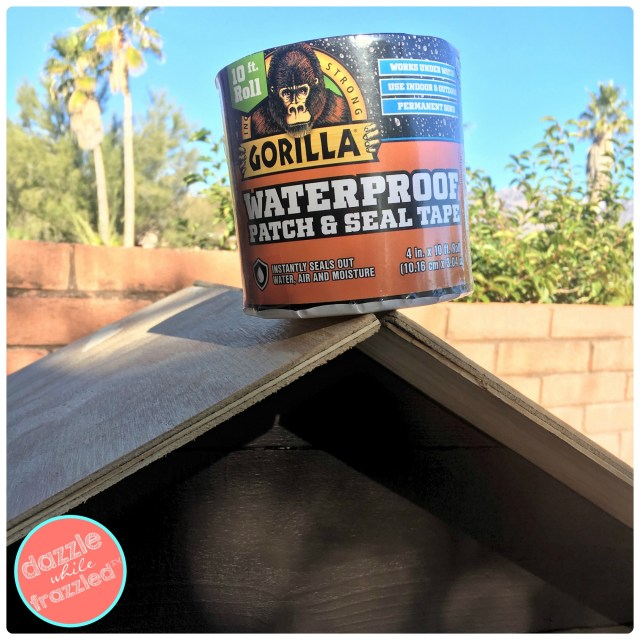 Use Gorilla Glue Waterproof Patch and Seal Tape to secure ends of plywood roof to protect from weather for DIY Little Free Library.