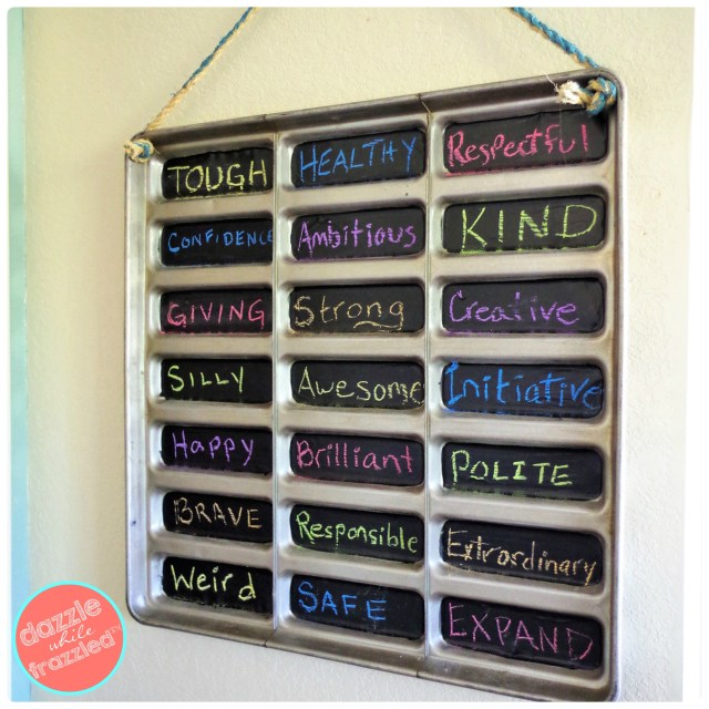 Insert sisal rope through metal tray to hang DIY chalkboard sign on the wall.