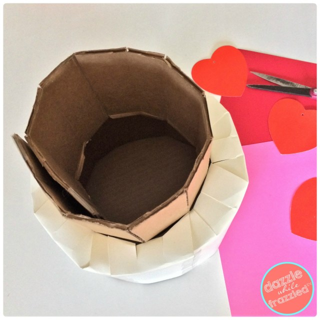 How to make a kids cute and sweet tiered cake Valentine's Day card box holder using cardboard and scrapbook paper.