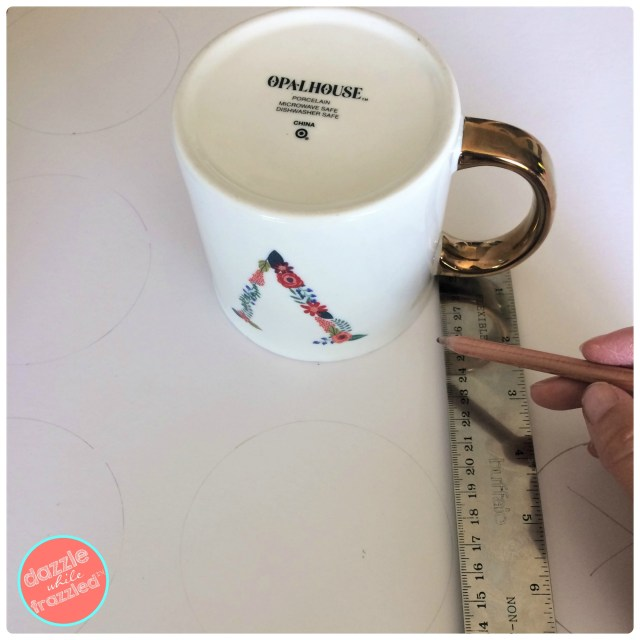 Use a coffee mug to make easiest, fastest polka dots for DIY wall art to disguise Nest wall thermostat.