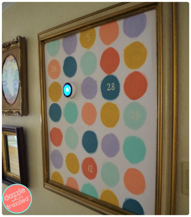 Disguise Nest thermostat in DIY polka dot wall art.