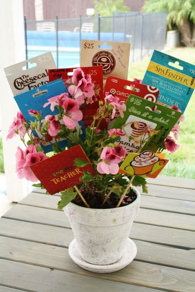 Insert gift cards within pretty potted plant as DIY gift card tree bouquet.
