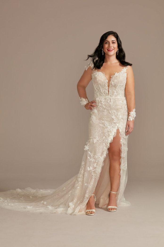 Bride wears ethereal 3D flower appliqué wedding dress with high slit