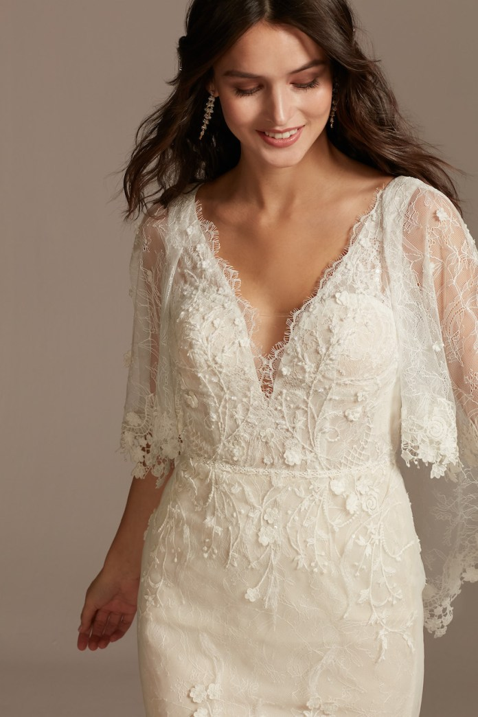 Bride wears ethereal lace wedding dress with crochet braid capelet
