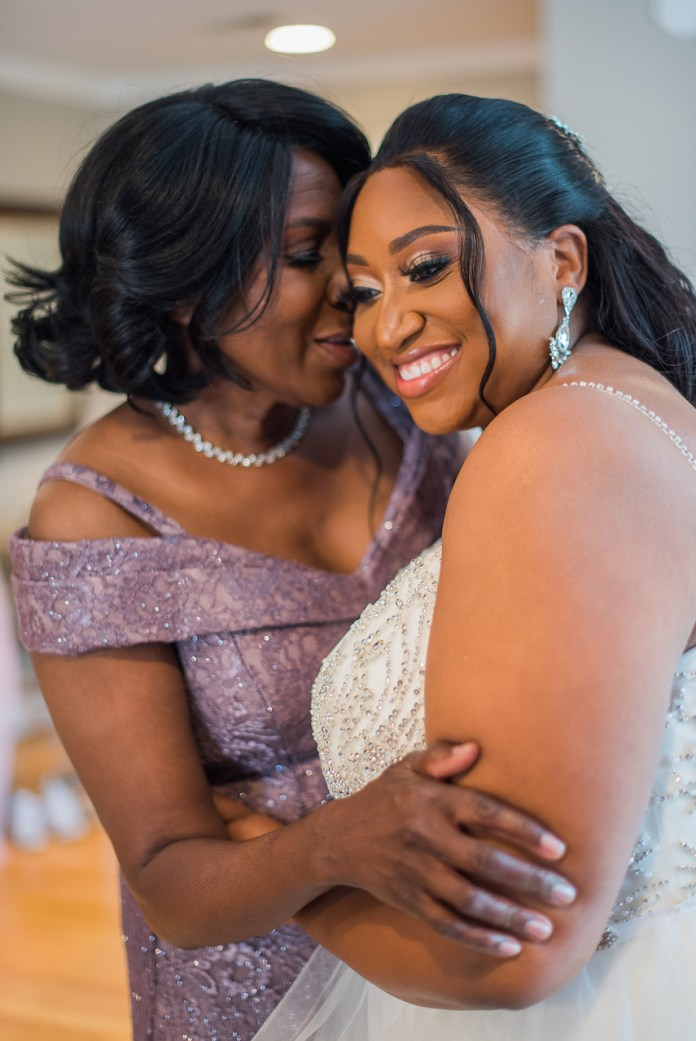Mother and bride are hugging