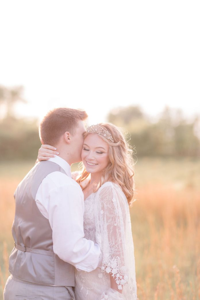 Bride and groom embrace at the golden hour
