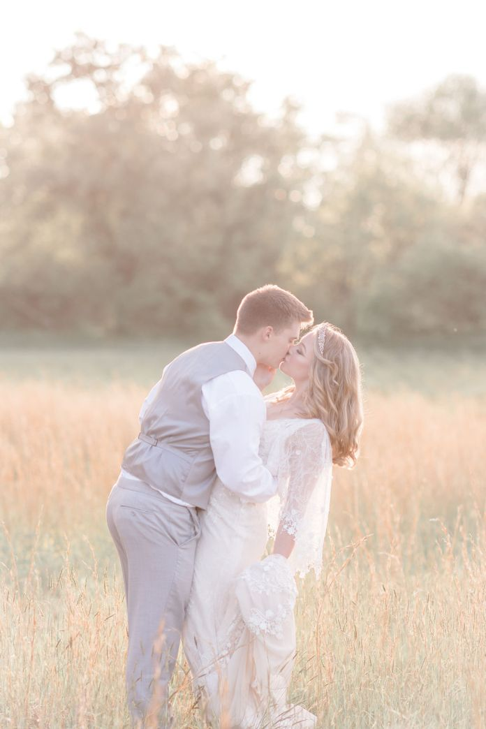 Bride and groom kiss at the golden hour at a wonderful spring wedding