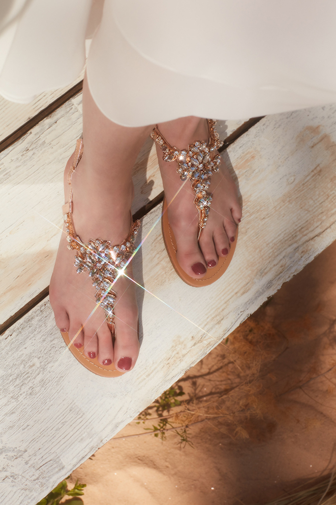 Beach wedding sandals with glittering details for brides