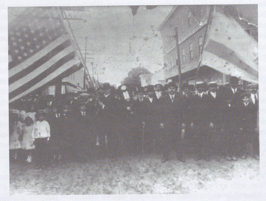Black and white photograph of people marching