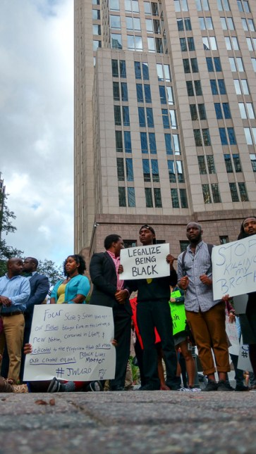 5:27pm: Young protesters gathered outside Bank of America headquarters after work. (David Boraks/WFAE)