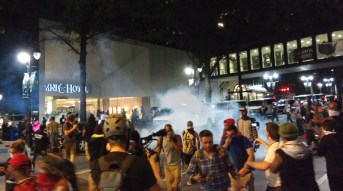 8:39pm: Police used tear gas to push the crowd back in front of the Omni, just moments after a protester was shot. Police said another civilian shot the 26-year-old man, who later died. (David Boraks/WFAE)