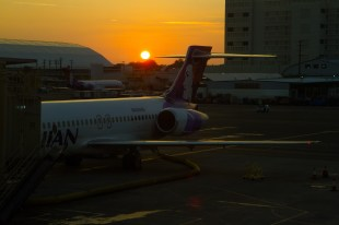 HONOLULU, HI - January 14, 2017: The sun sets over the Honolulu airport after our long day of travel.