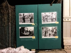 """Wheat-pasted images outside the Bronx Documentary Center from their current exhibit, """"Whose Streets? Our Streets!"""""""