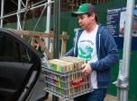 Ryan Coleman helps his friend move more than 60 crates of records on Saturday.