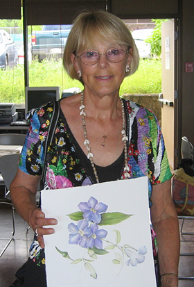 Sue Kuuskmae with colored pencil painting.