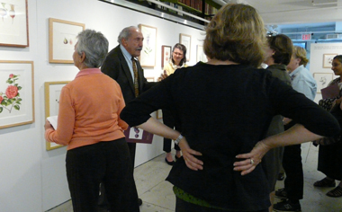 Dick Rauh discusses the paintings at the exhibition.