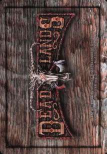"The back of a Doomtown card. It shows a wooden background with the words ""Deadlands"" printed in an old western font. A Cow skull is in the middle"