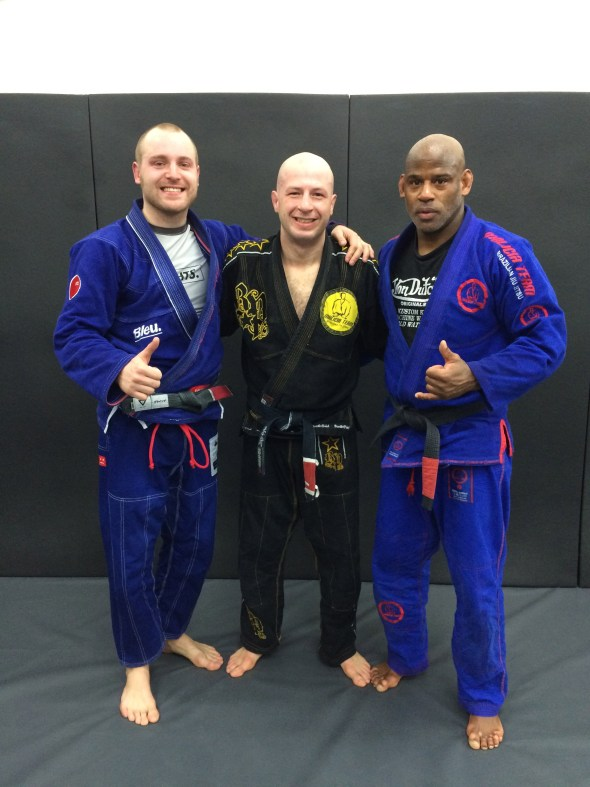 Dimitri with a couple of Malicia Team Black Belts