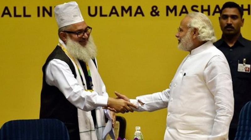 Prime Minister Narendra Modi shakes hands with AIUMB Founder President, Syed Mohammad Ashraf Kichhowchhwi at the opening ceremony of World Sufi Forum at Vigyan Bhawan in New Delhi on Thursday. (Photo: PTI)