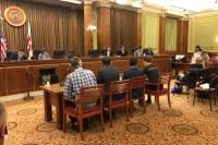 Steering Committee Member Meredith, far right, testifying