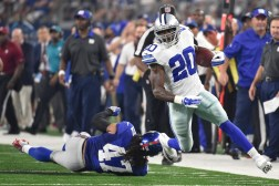 Dallas Cowboys running back Darren McFadden (20) gets past New York Giants linebacker Uani' Unga (47) during the first half of an NFL football game Sunday, Sept. 13, 2015, in Arlington, Texas. (AP Photo/Michael Ainsworth)