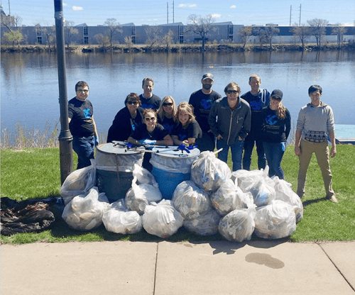 DC Group employees and earth day bounty of trash bags