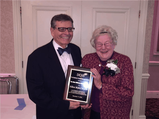 Eileen Mylod Hayden receives the award from Lou Lewis