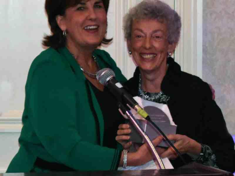 Linda Hubbard accepts from Denise Van Buren