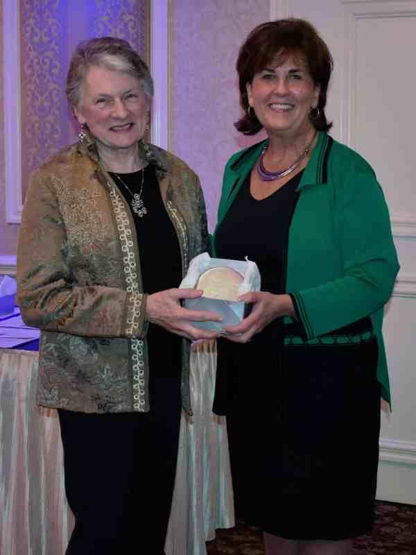 etsy Strauss receives the award from Denise Van Buren.