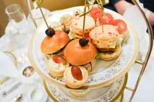 Afternoon tea cake stand tea filled with cones, finger sandwiches. Marmalade, lemon curds, and herbed butter at the Willard Intercontinental Hotel | Photo courtesy of Gigi Smith