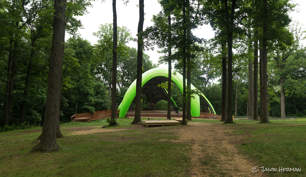 From the rear of the Merriweather Post Pavillion, take the small path through the woods to get to the Chrysalis.