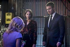 "Arrow -- ""Code of Silence"" -- Image AR414b_0121b.jpg -- Pictured (L-R):  Emily Bett Rickards as Felicity Smoak, Willa Holland as Thea Queen, and Stephen Amell as Oliver Queen -- Photo: Katie Yu/ The CW -- © 2016 The CW Network, LLC. All Rights Reserved."