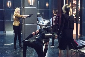 """Arrow -- """"Beacon of Hope"""" -- Image AR417b_0406b.jpg -- Pictured (L-R): Emily Kinney as Brie Larvan, Stephen Amell as Green Arrow, Willa Holland as Thea Queen and Emily Bett Rickards as Felicity Smoak -- Photo: Dean Buscher/The CW -- © 2016 The CW Network, LLC. All Rights Reserved."""