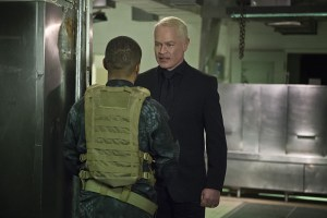 """Arrow -- """"Genesis"""" -- Image AR420a_0407b.jpg -- Pictured (L-R): Eugene Byrd as Andy Diggle and Neal McDonough as Damien Darhk -- Photo: Diyah Pera/The CW -- © 2016 The CW Network, LLC. All Rights Reserved."""