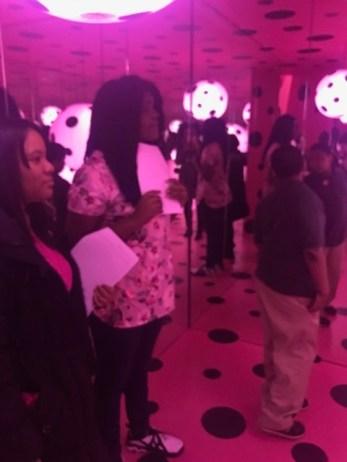 Students analyse Yayoi Kusama's Infinity Mirrors exhibit.