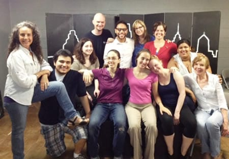 Susan Porter (on stool) and members of the cast and crew of Having It All: The Musical