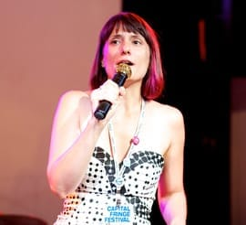 Julianne Brienza announcing the Capital Fringe Best Of Awards. (Click this image for more Ryan Maxwell photos from closing night)